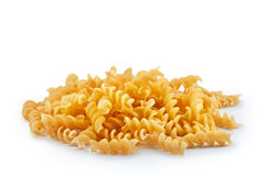 Pile of golden fusilli pasta Royalty Free Stock Photos