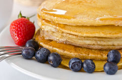 Pile of golden pancakes Royalty Free Stock Image