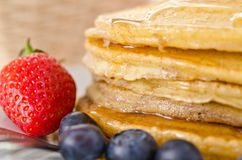 Pile of golden pancakes Stock Photography