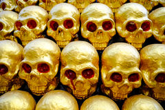 Pile of golden skulls with red eyes. closeup Stock Photography