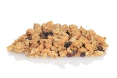 Pile of granola raisin almond cereal. On a white background royalty free stock images