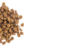 Pile of granulated animal feeds on white background Stock Photos