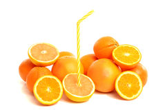 Pile of grapefruits and oranges with a straw. Royalty Free Stock Images