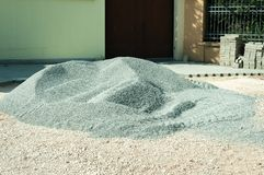 Pile of gravel stone on the street paving reconstruction site in the city.  Royalty Free Stock Images