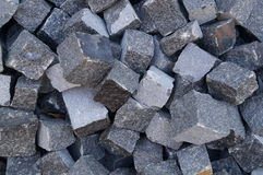 Pile of gray cube granite stones Royalty Free Stock Images