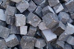 Pile of gray cube granite stones Royalty Free Stock Photos