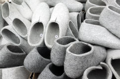 Pile of gray traditional felt slippers Stock Photos