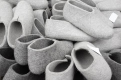 Pile of gray traditional felt slippers Stock Images