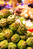 Pile of green artichokes at the boqueria market in Barcelona Stock Photos