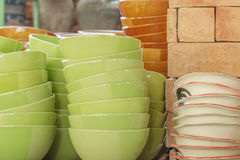 Pile of green and brown bowl in warehouse. Stock Images
