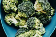 Pile of Green Fresh Broccoli over black wooden background. Healt. Hy food, diet concept. Top view Stock Image