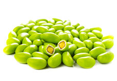 A pile of green gumballs with nuts isolated  on a white backgrou Royalty Free Stock Photo