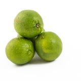 Pile of Green Limes over white background Royalty Free Stock Photography