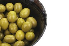 Pile of  green olives in a bowl isolated Royalty Free Stock Photos