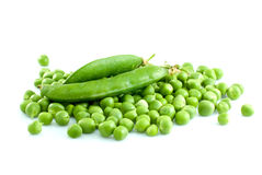 Pile of green peas and pair of pods. Isolated on the white background Stock Photo