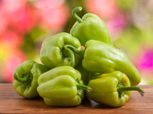 Pile green pepper on a wooden table with  blurred background Stock Photo