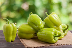 Pile green pepper on a wooden table with blurred background Stock Images