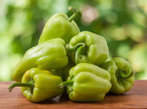 Pile green pepper on a wooden table with  blurred background Stock Photography