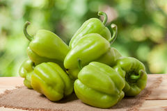 Pile green pepper on a wooden table with blurred background Royalty Free Stock Photos