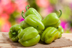 Pile green pepper on a wooden table with blurred background Stock Photos