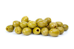 Pile of  green pitted olives. On the white background Royalty Free Stock Photos