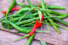 Pile of green and red peppers Stock Images