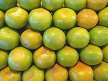 Pile of green tangerines. This type of Asian tangerine has green and orange skin. The taste is very sweet and little sour. Stock Photography