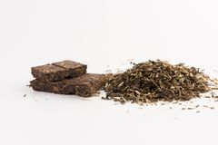 Pile of green tea isolated on white. Background royalty free stock image