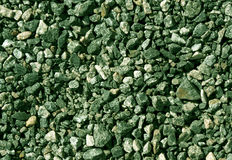 Pile of green toned gravel stones. Stock Images