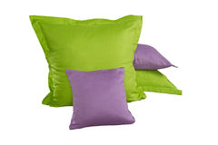 Pile of green and violet pillows Stock Photos