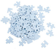 Pile of grey blank puzzle pieces Royalty Free Stock Image