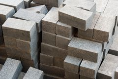 Pile of  grey granite pavement bricks on a palette are ready to be laid in the sidewalk Stock Photo