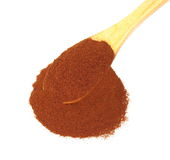 Pile ground cinnamon with wooden spoon Stock Image