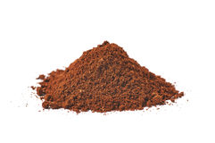 Pile of the ground coffee flakes isolated. Over the white background stock photography