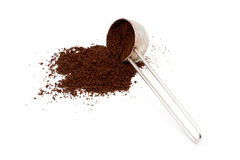 A pile of ground coffee and a spoon Stock Image