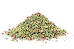 Pile of ground dried Basil isolated on white. royalty free stock photos