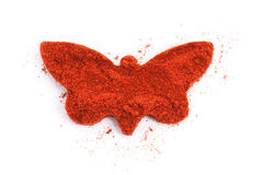 Pile of ground paprika isolated in butterfly shape stock images