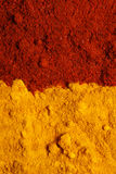 Pile of ground turmeric and paprika Royalty Free Stock Photos