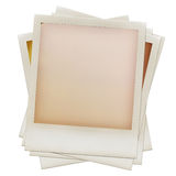 Pile of grungy blank instant film frames. A pile of grungy blank instant film frames with abstract  filling, isolated on white, kind of a background, vintage Royalty Free Stock Photo