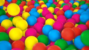 Multicolored spheres closeup in pool for children fun abstract background