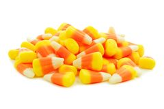 Pile of Halloween candy corn over white Royalty Free Stock Image