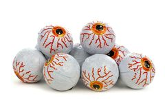 Pile of Halloween candy eyeballs over white Royalty Free Stock Images