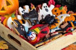 Pile of halloween cookies in wooden basket Royalty Free Stock Image