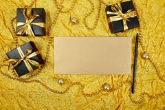 Pile of handmade luxury black gift boxes with gold ribbon DIY decoration, blank sheet paper for greeting text, gold wedding stock photography