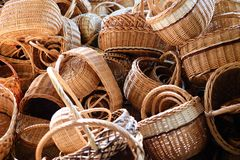 Pile of handmade vine baskets on a market Stock Photos