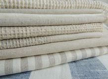 Pile of handmade waffle linen cotton napkins, towels on white linen background. Stock Photography