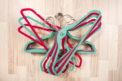 Pile of hangers arranged on the floor. Stock Images