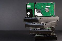 Pile of hard drives at black background Royalty Free Stock Image