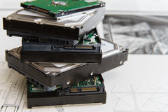 Pile of  hard drives at white background Stock Photo