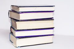 A pile of hardback books on a white background Royalty Free Stock Images